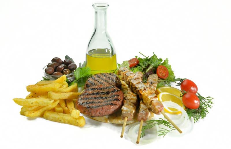 De Griekse geroosterde ongezonde kost van de de hamburgersandwich van het souvlakivleesballetje royalty-vrije stock foto's
