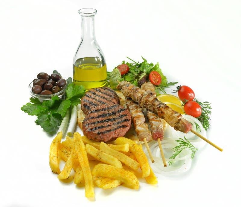 De Griekse geroosterde ongezonde kost van de de hamburgersandwich van het souvlakivleesballetje royalty-vrije stock foto