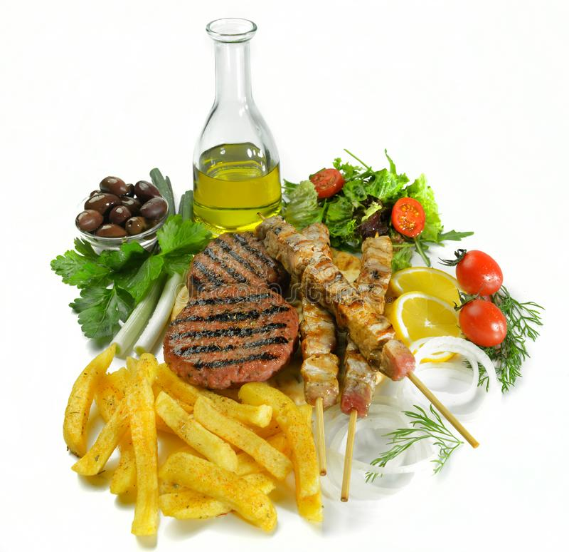 De Griekse geroosterde ongezonde kost van het de hamburgergedeelte van het souvlakivleesballetje royalty-vrije stock foto's