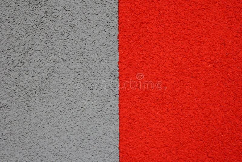 de grijs-rode pleisterbouw, structuur royalty-vrije stock foto's