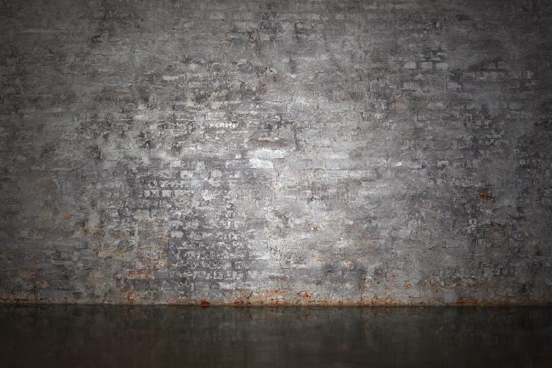 De grijze bakstenen muur