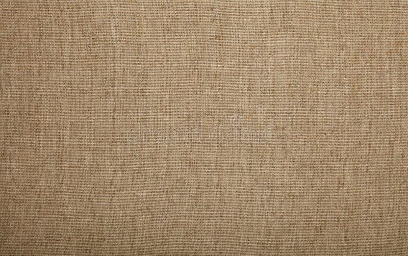 De grijze bruine achtergrond van de het canvastextuur van het vlaslinnen stock afbeeldingen