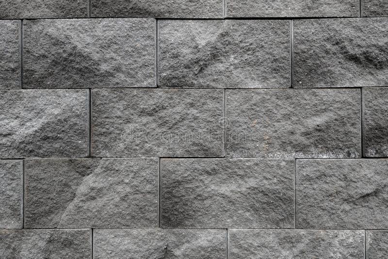 De grijze muuroppervlakte gebruikt heel wat bakstenen Of oud zwart bakstenen muur abstract patroon stock afbeeldingen