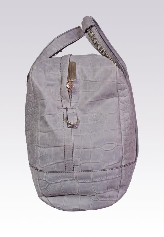 De grijze zak van de leervrouw