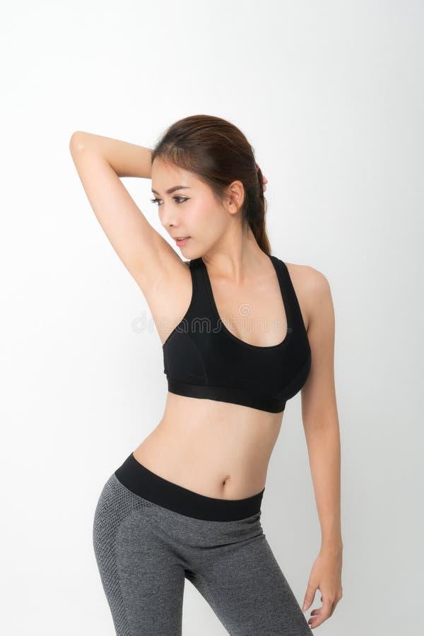 De groeiportret van geschiktheidsvrouw in sportkleding stock afbeeldingen