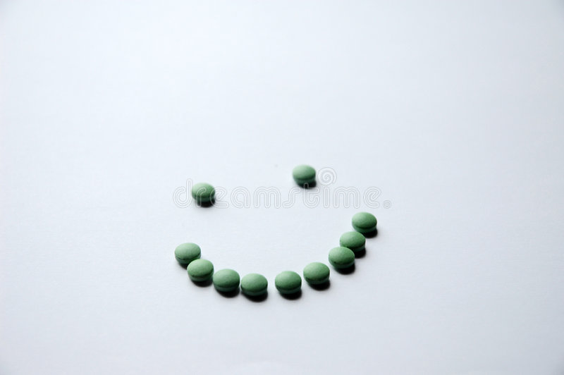 De groene Glimlach van de Pil stock foto's
