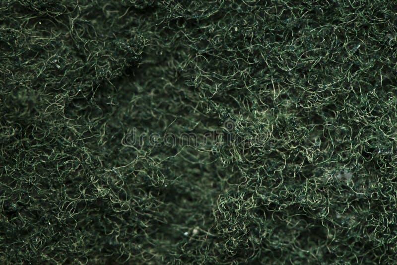De Groene schuursponsjetextuur, schrobt schuurbeurtstootkussen royalty-vrije stock foto