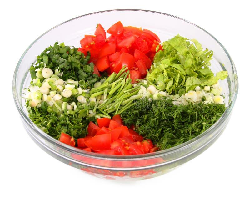 De groenten van de salade en greens in een glasvaas stock foto's