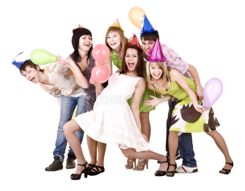 De groep tieners viert verjaardag. stock afbeelding