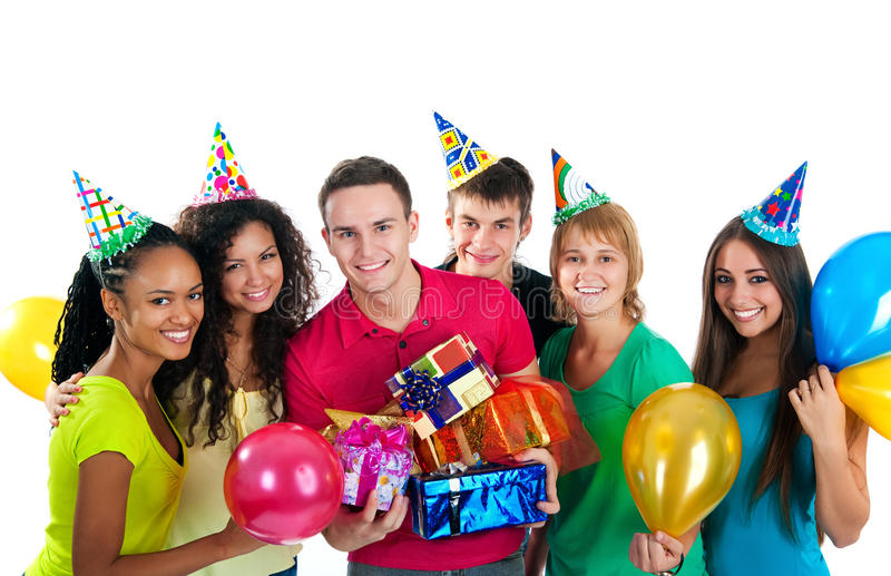 De groep tieners viert verjaardag over wit royalty-vrije stock afbeeldingen