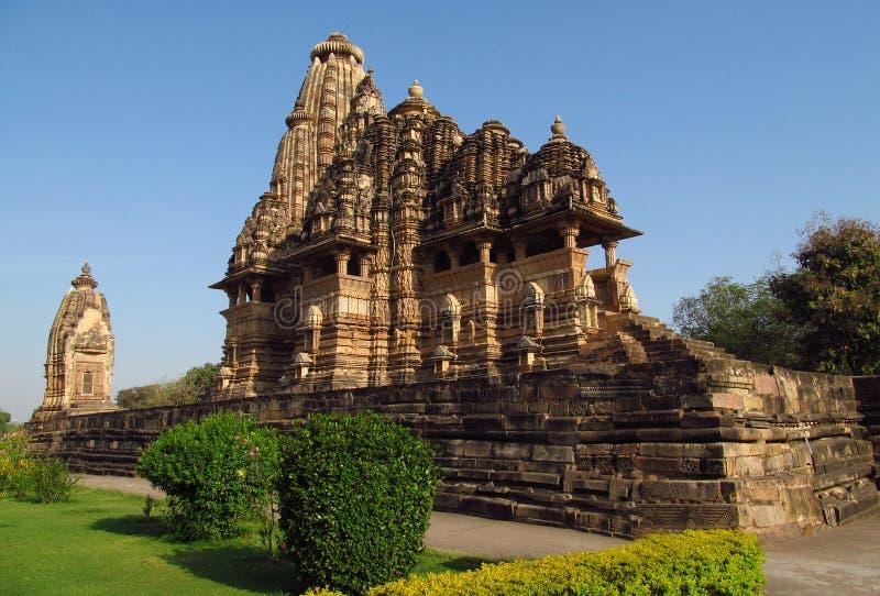 De Groep van de Khajurahotempel Monumenten in India met erotische beeldhouwwerken op de muur royalty-vrije stock fotografie