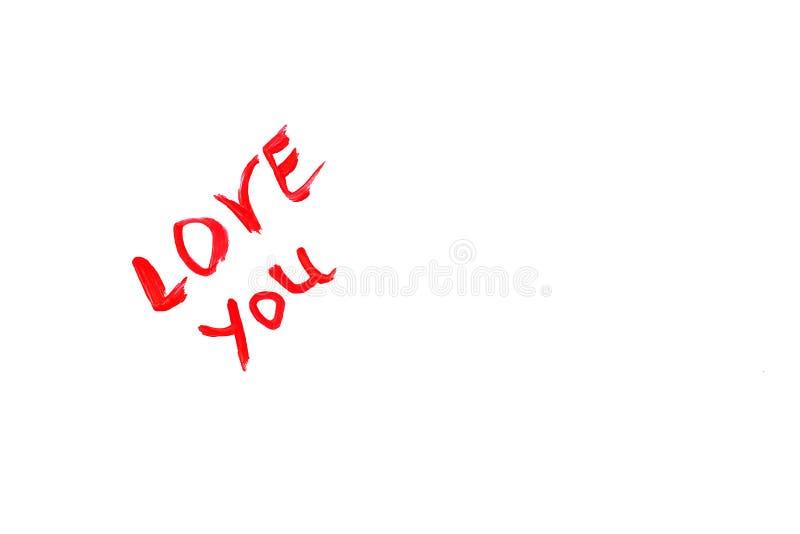 De groetkaart met tekst in lippenstift 'houdt van u 'wordt geschreven met een lege plaats voor tekst die stock afbeelding