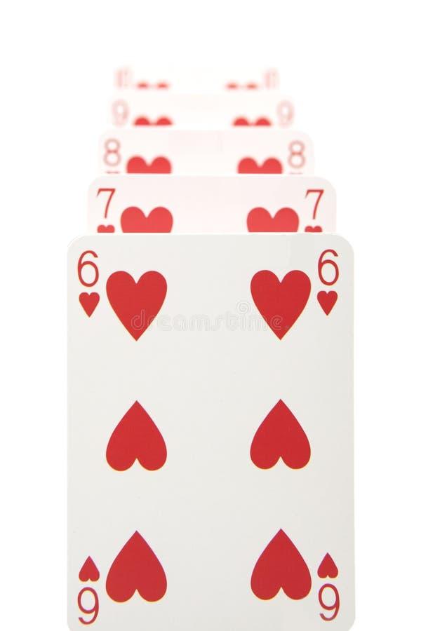 De grondslag van een kaartenhuis stock foto