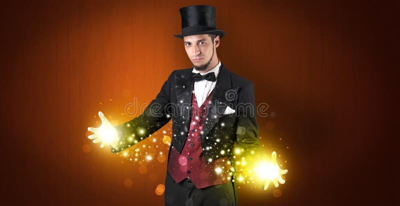 De grootmacht van de illusionistholding op zijn hand stock foto