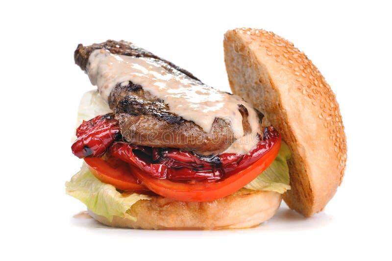 De grote smakelijke die hamburger van de lapje vleeshamburger op wit wordt geïsoleerd royalty-vrije stock foto
