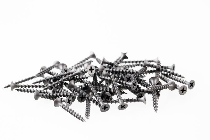 De grote zelf onttrekkende schroeven van het schroevenstilleven op witte achtergrond stock afbeelding