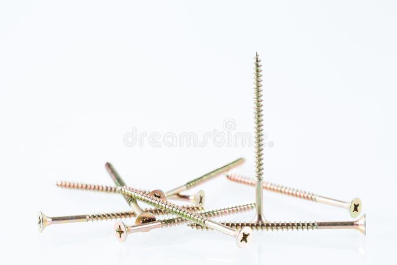 De grote zelf onttrekkende schroeven van het schroevenstilleven op witte achtergrond stock foto's