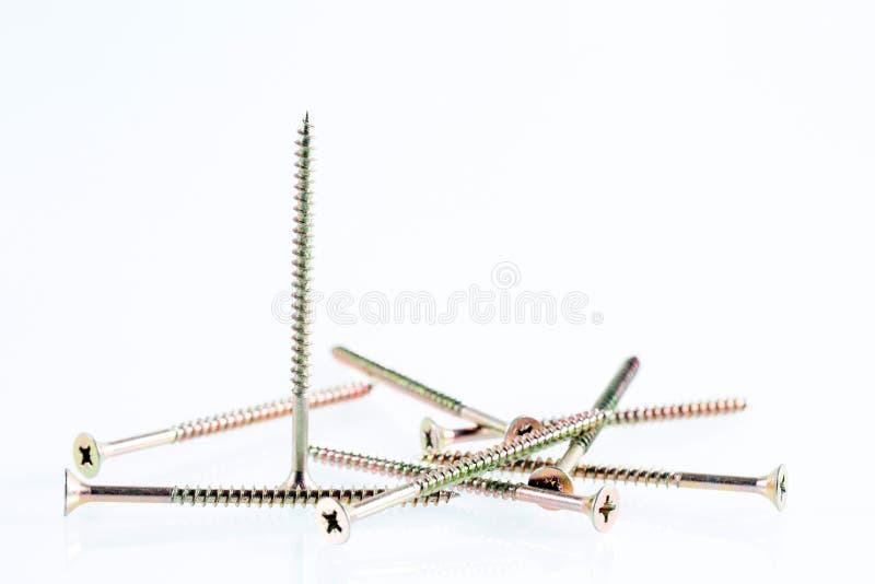 De grote zelf onttrekkende schroeven van het schroevenstilleven op witte achtergrond stock fotografie