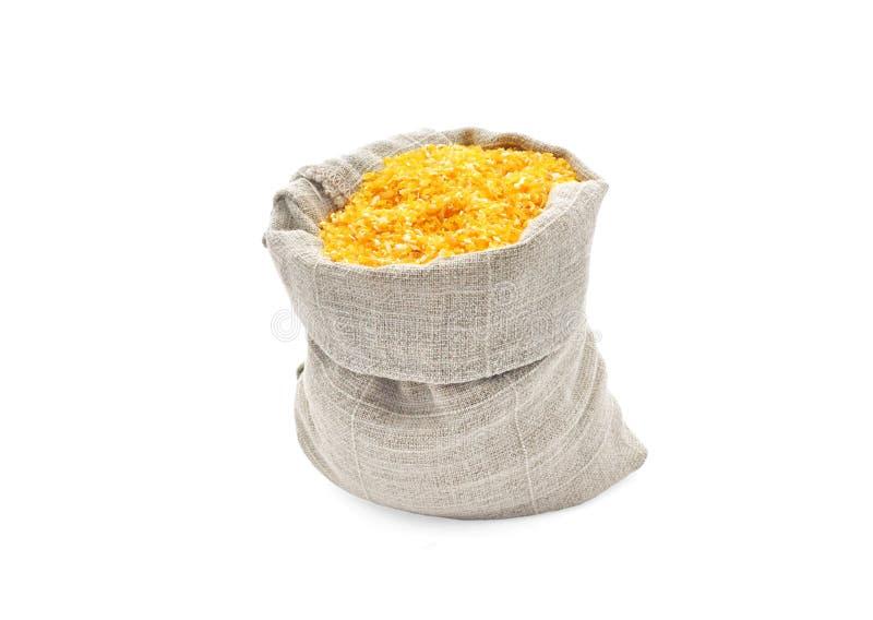 De grutten van het graan in een zak. stock foto