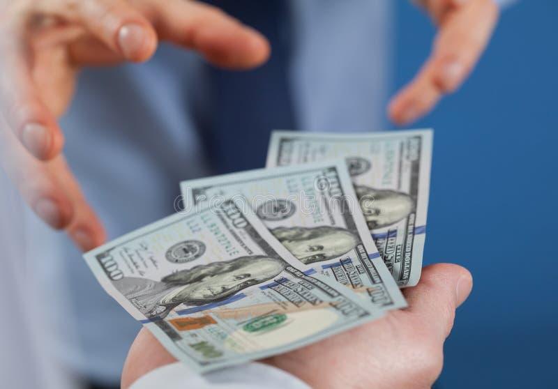 De gulzige zakenman wil geld nemen royalty-vrije stock fotografie