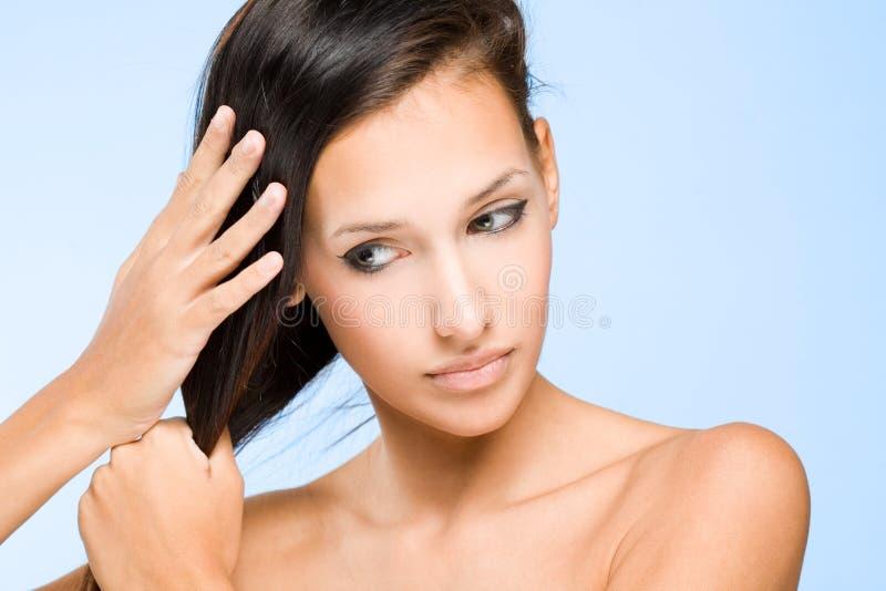 De haarcontrole. stock fotografie