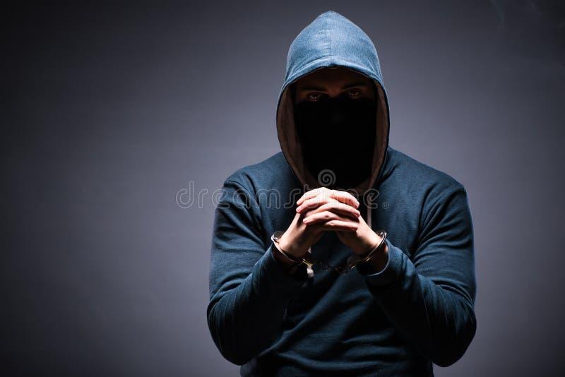 De hakker voor deze misdaden wordt gevangen die royalty-vrije stock foto's