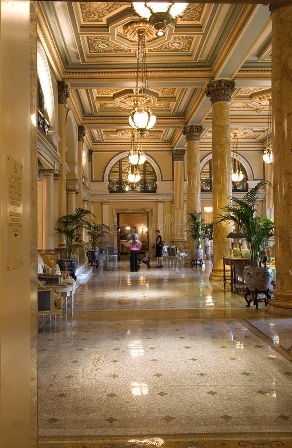 De hal van het hotel stock afbeeldingen