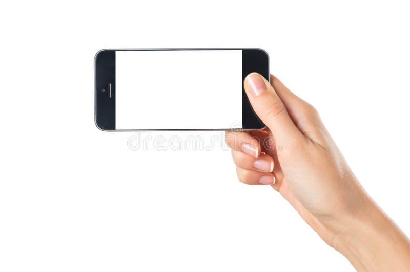 De hand die van de vrouw mobiele telefoon houden stock afbeelding