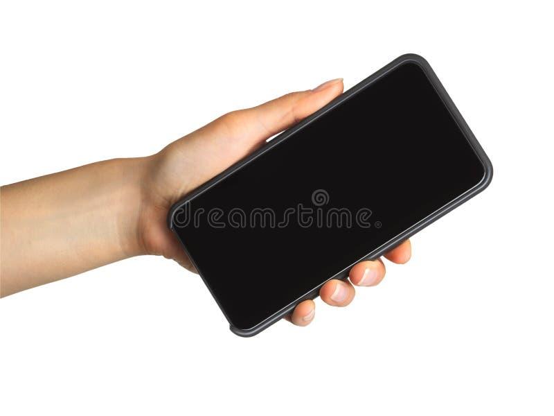 De hand die van vrouwen zwarte smartphone, concept tonen het mobiele winkelen royalty-vrije stock foto's