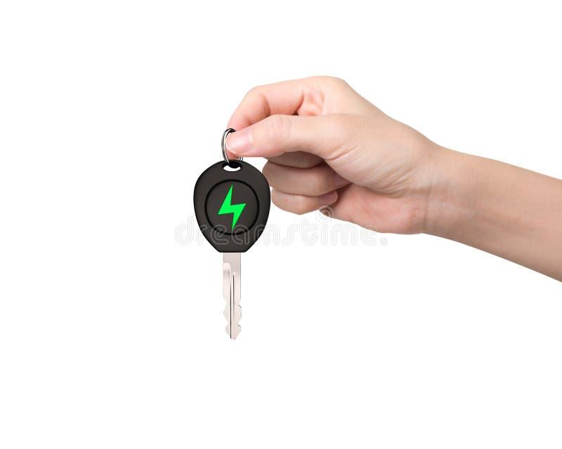 De hand geeft elektrische autosleutel met het groene teken van de bliksembout royalty-vrije stock foto's