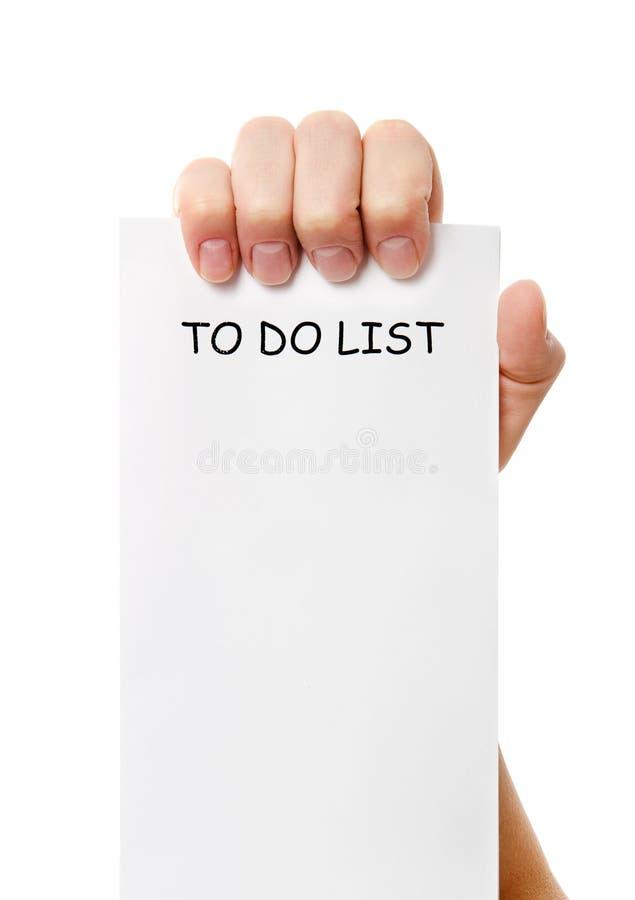 De hand hield van a om lijstdocument nota te doen stock afbeelding