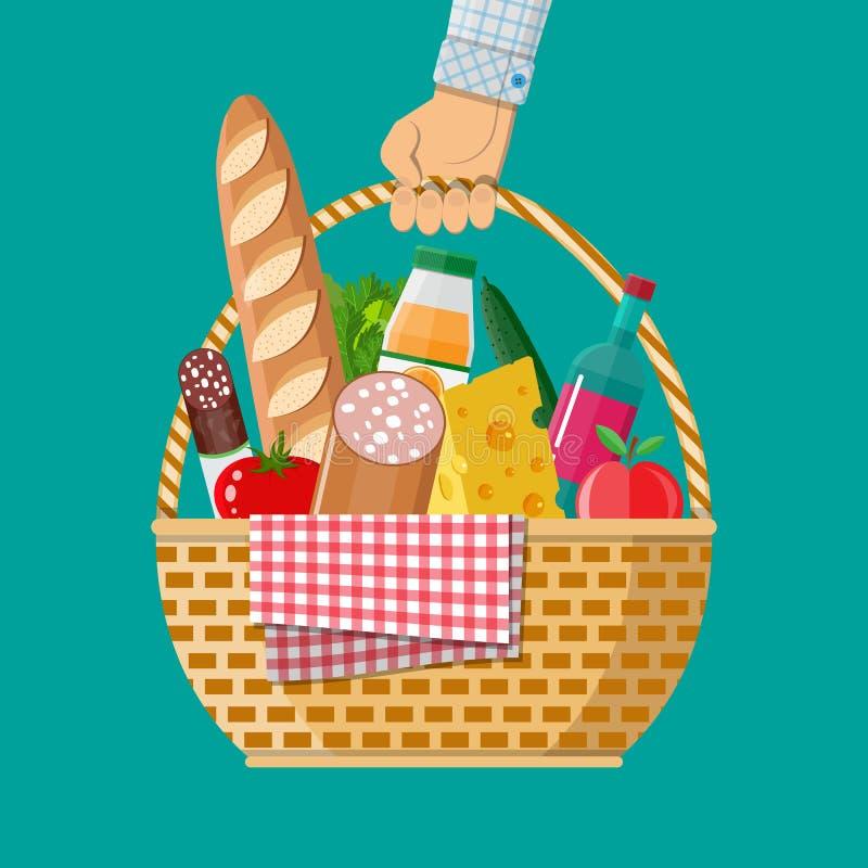De hand houdt het rieten hoogtepunt van de picknickmand van producten vector illustratie
