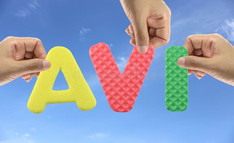 De hand schikt alfabet AVI van acroniem de Audiovideo doorschiet stock fotografie