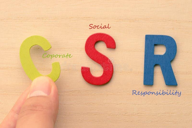 De hand schikt brieven als CSR stock fotografie
