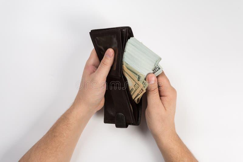 De hand toont geld in de portefeuille royalty-vrije stock foto