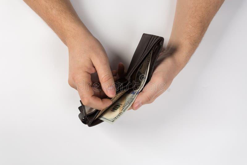 De hand toont geld in de portefeuille royalty-vrije stock afbeeldingen