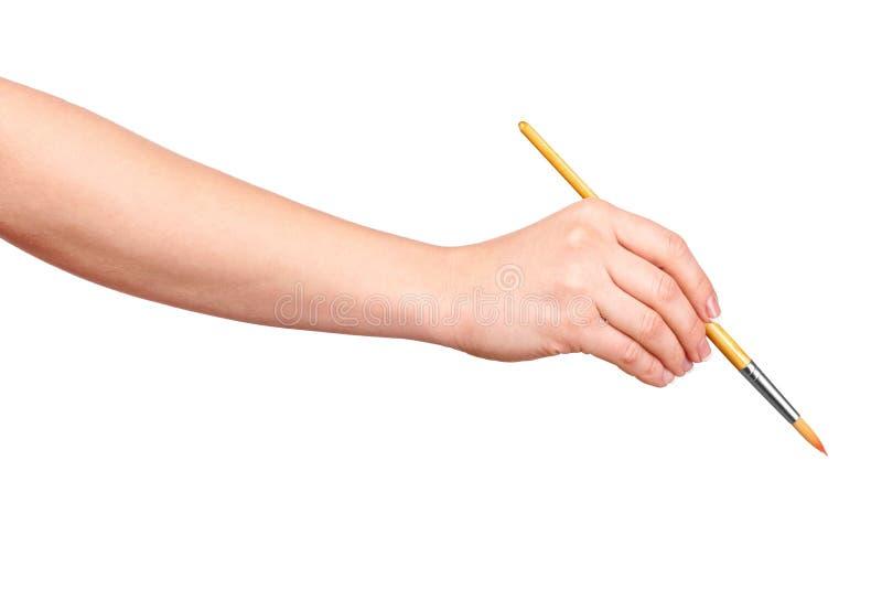 De hand trekt een borstel stock afbeelding