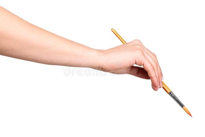 De hand trekt een borstel stock afbeeldingen