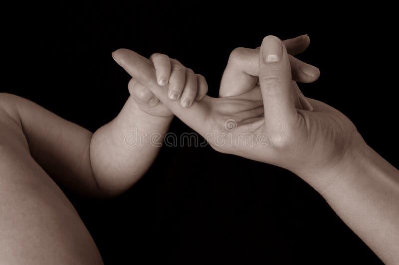 De hand van de baby `s stock foto