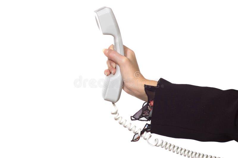 De hand van de vrouw met een telefoonontvanger stock foto's