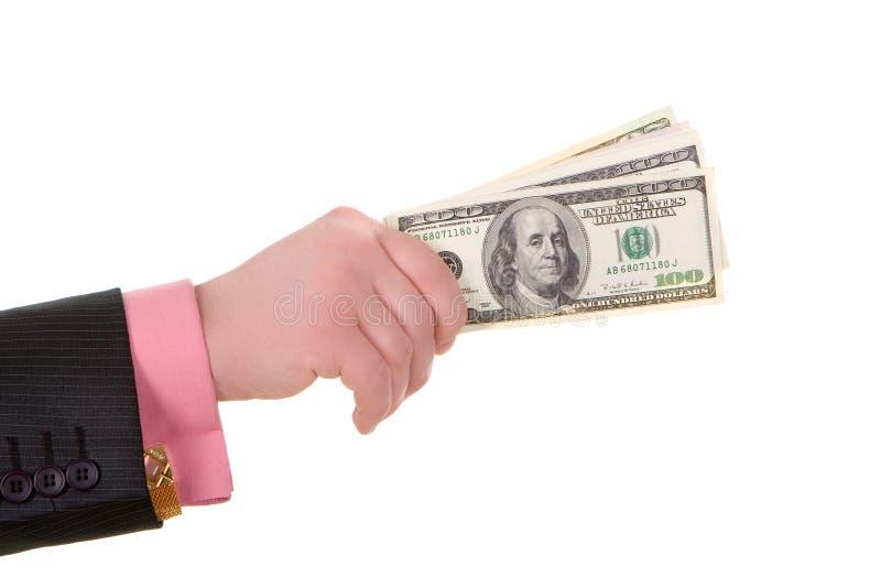 De hand van de zakenman met geld stock foto's
