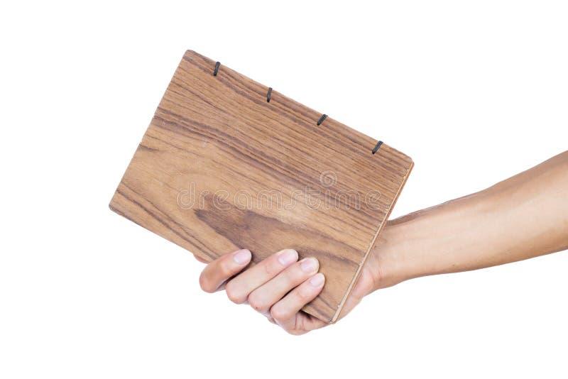 De hand van de handholding - gemaakt die boek op witte achtergrond wordt geïsoleerd Knippende weg royalty-vrije stock afbeelding
