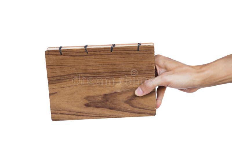 De hand van de handholding - gemaakt die boek op witte achtergrond wordt geïsoleerd Knippende weg stock fotografie