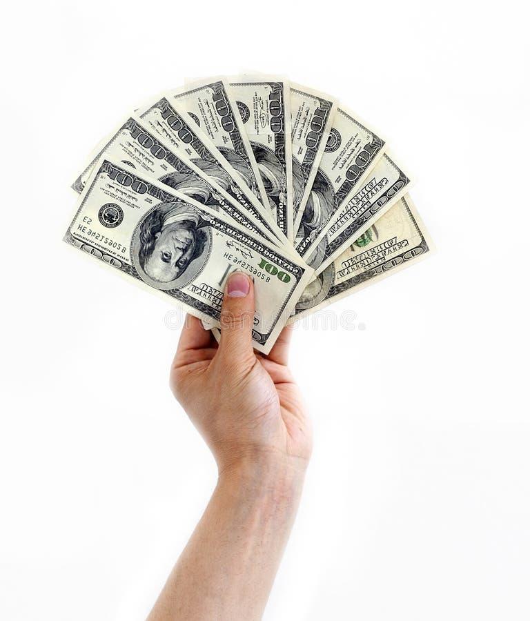 De hand van het geld stock fotografie