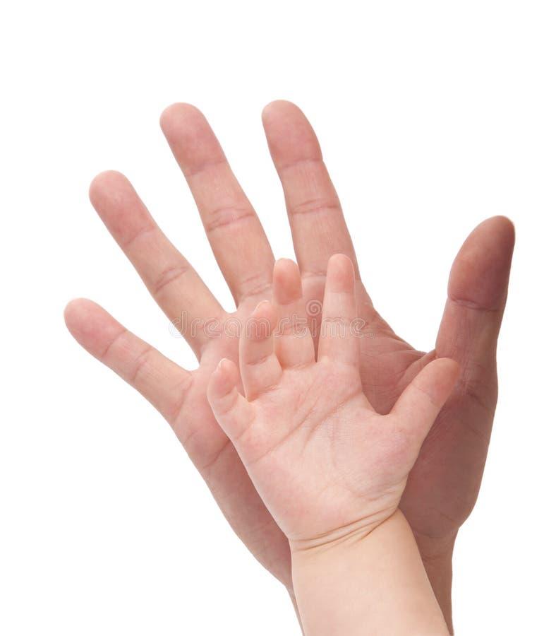 De hand van het kind en van de vader royalty-vrije stock foto