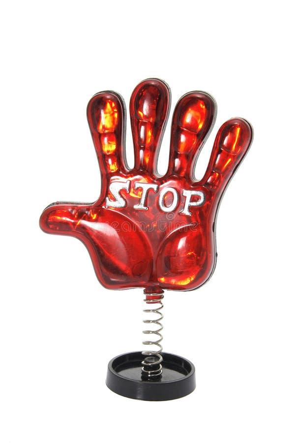 De Hand van het stuk speelgoed op Rol stock foto