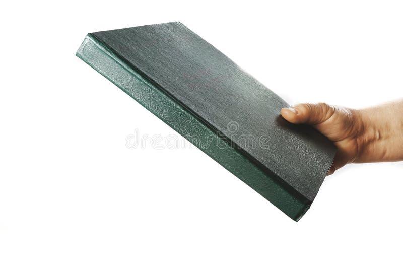 De hand van de vrouw houdt boek stock foto