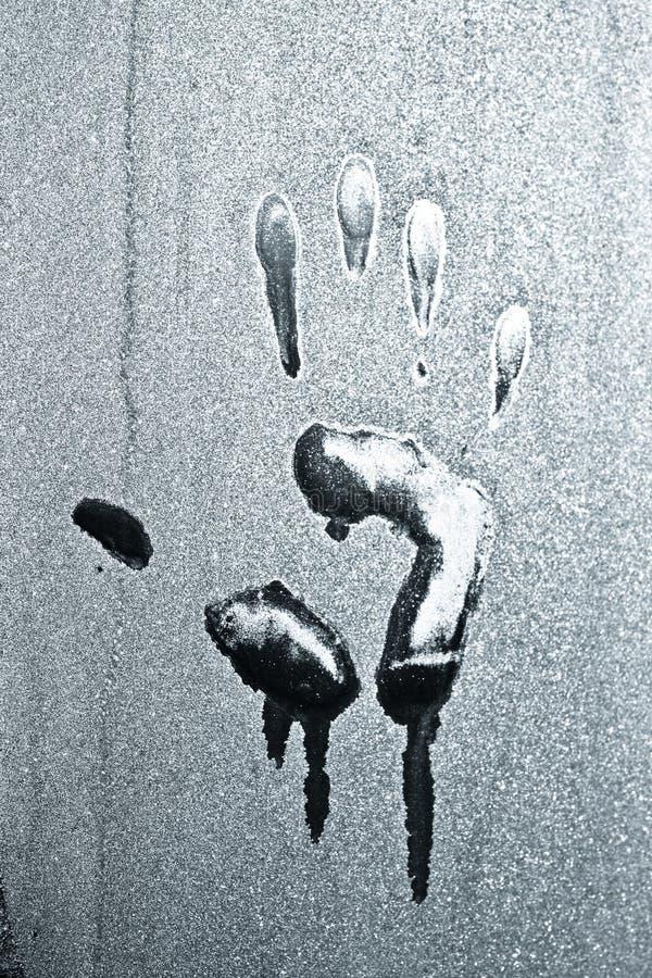 De handaf:drukken van de palm op glas royalty-vrije stock foto