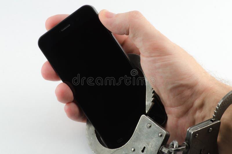 De handen cuffed telefoon stock afbeeldingen