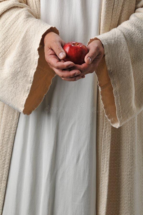 De handen die van Jesus een appel houden royalty-vrije stock foto